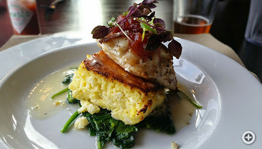 Pan Roasted Gulf Grouper with feta soufflé, braised spinach, tomato jam and citrus butter at Boshamps