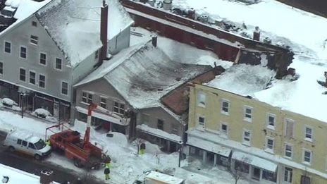 From above: Boston roofs buckle in snow