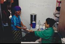 Nurse handing patient materials.