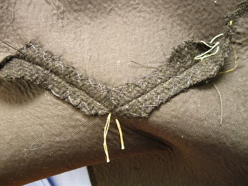 Coat collar inside collar catch stitched