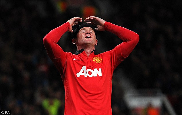 What did I do? Rooney holds his head in his hands after his extraordinary miss