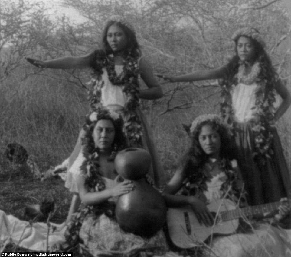 Four hula dancers pose for a photograph in the crater of Punch Bowl Mountain in a picture taken more than a century ago in around 1901