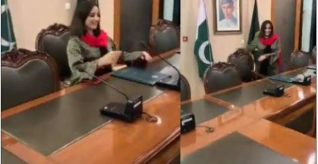 Imran Khan sits in the PM's office