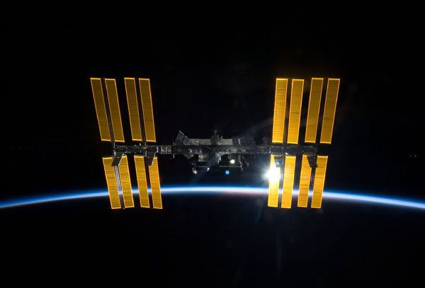 The International Space Station, with orbital sunset behind it.