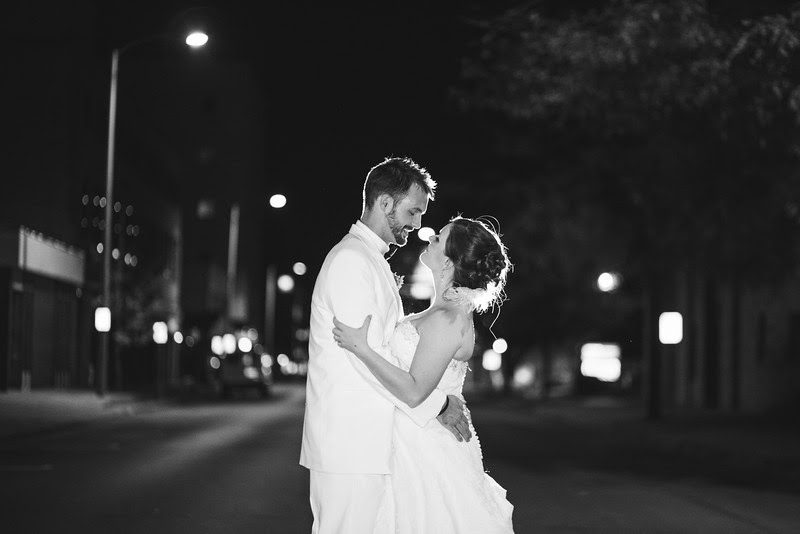 romantic Outdoor portraits at night with the bride and groom outside of Rockford Women's club, where they held their reception. They took photos on church steps and in the middle of the road where they were back lit with streetlights.