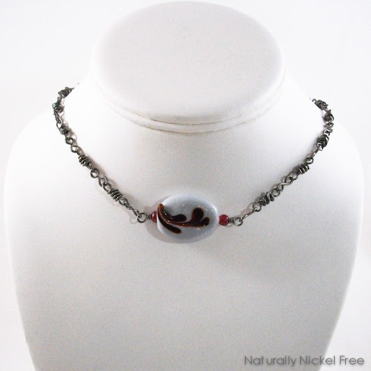 Niobium Choker with Red Floral Design Glass Focal Bead