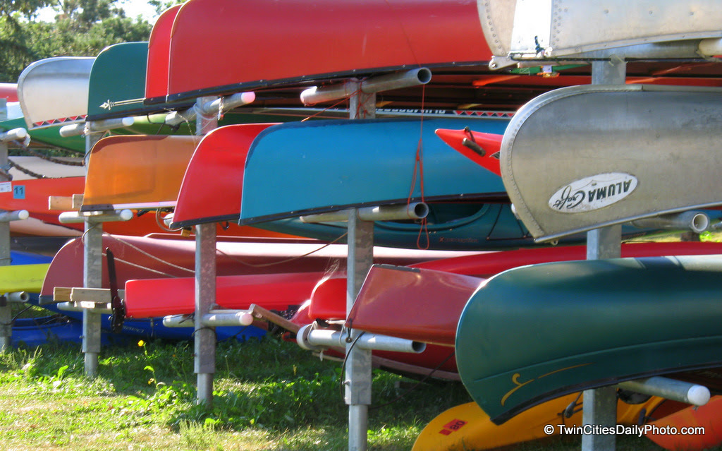 All sizes, shapes and colors of canoes at Lake Calhoun in Minneapolis.