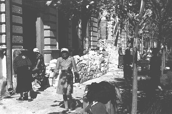 Jewish women at forced labor in the process of clearing rubble from the main street. Kishinev, Bessarabia,  August 12, 1941.