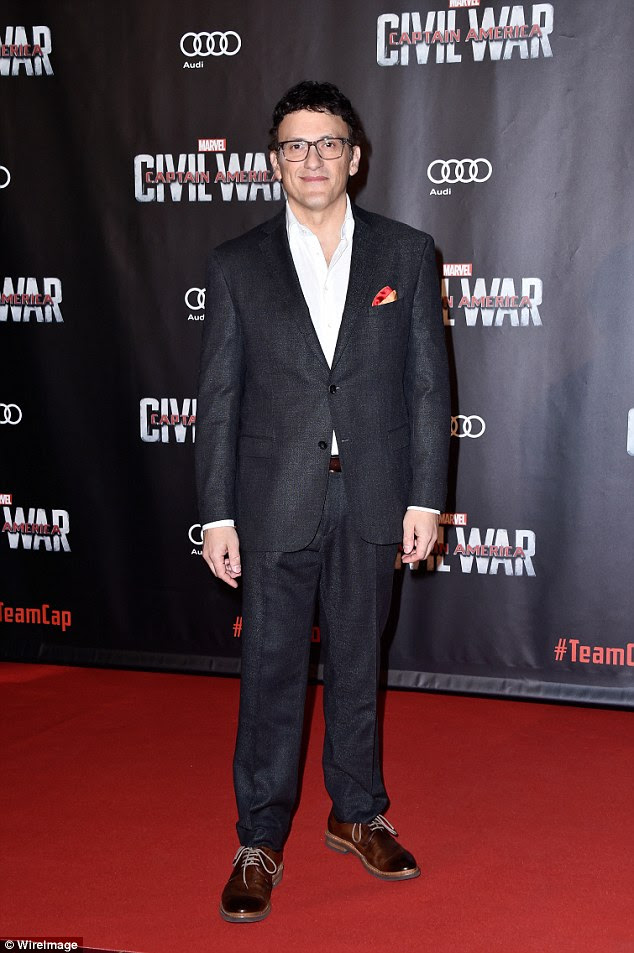 Main man:Director Anthony Russo also took the red carpet, going for a more conventional look than his subjects as he sported a grey suit with smart brown shoes