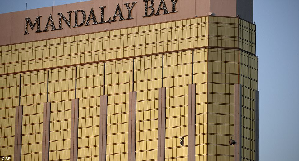 Images of the Mandalay Bay Resort show two windows blown out on the 32nd floor of the building (above) that Paddock smashed out so he could shoot crowds from two locations