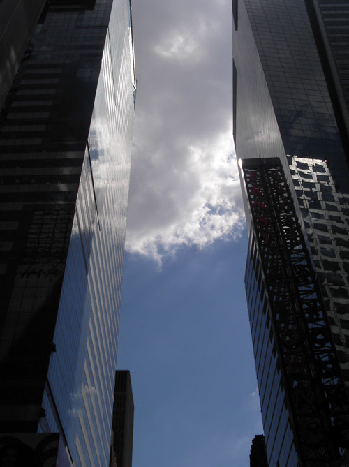 a Manhattan canyon with cloud cover, NYC
