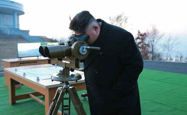 Kim Jong-Un, pictured, gave the order for the drill to start, North Korea's official Korea Central News Agency reported. 'Feasting his eyes on the trails of ballistic rockets', he praised the Hwasong artillery unit that carried it out, the government news agency said
