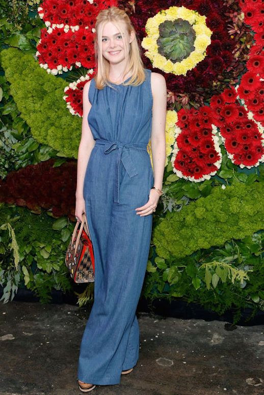 Le Fashion Blog Elle Fanning Denim Jumpsuit Mini Tote Bag Leather Wedges Via Cosmopolitan