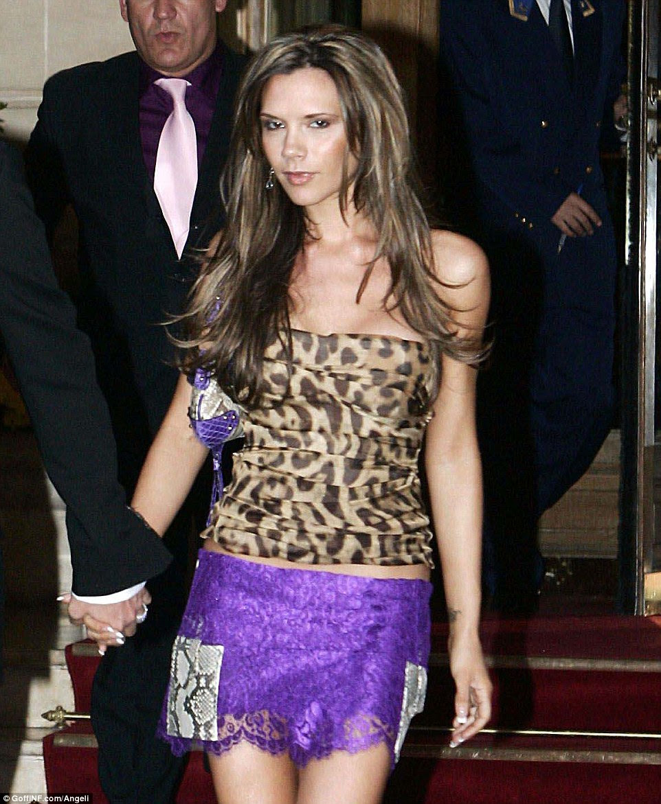 Leopard print, lace, snakeskin¿ out in Paris in 2005, Victoria squeezes several tacky trends into one unsightly outfit