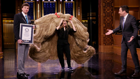 Drew Barrymore wears world's widest wig on The Tonight Show Starring Jimmy Fallon