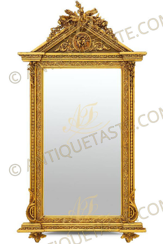 A prepossessing Louis XVI Revival architectural form carved and patina gilt pier grand mirror