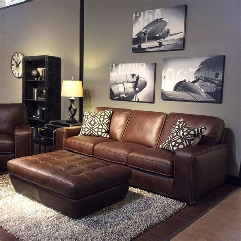 family room  warm gray walls black  white art