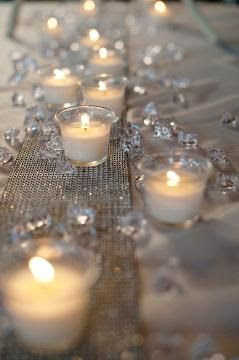This would be gorgeous as a runner down a long table. Cheap too! Use clear , flat marbles and a 3 inch (or so) wide ribbon. Even lace would be pretty or a silver mesh.