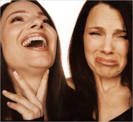 Two women tongue kissing