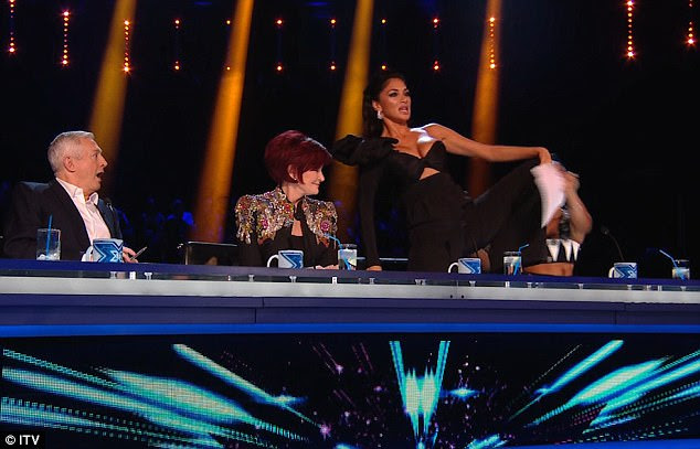 Leggy:A busty Nicole then got up and started gyrating saying 'When you sing it serves my soul like that' before putting her leg on the desk