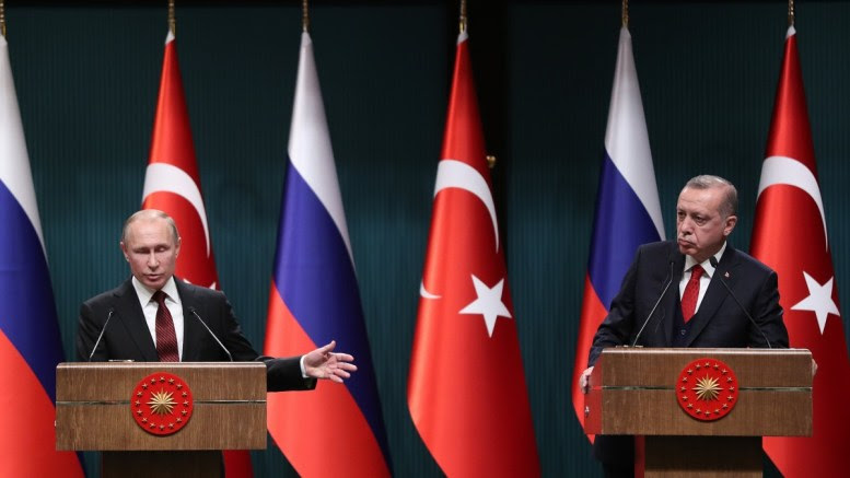 Turkish President Recep Tayyip Erdogan (R) and Russian President Vladimir Putin (L) during a press conference after their meeting at the Presidential Palace in Ankara, Turkey 03 April 2018. EPA, TOLGA BOZOGLU