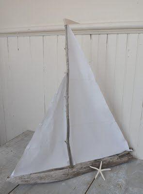 white linen driftwood sailboat