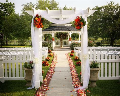 garden gazebo wedding ceremony aisle tulle flowers fabric