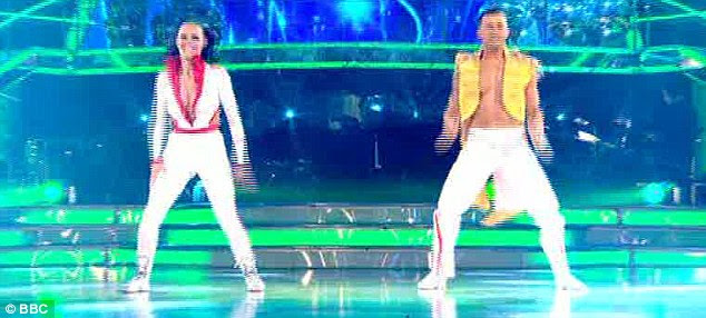 Ready to go: Kara wore a tight, low-cut jumpsuit as she and Artem performed to I Like The Way You Move