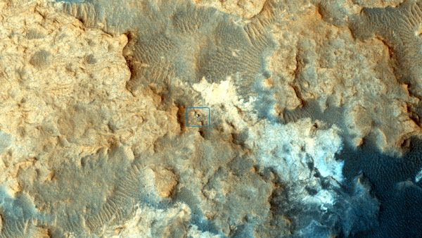An image of NASA's Curiosity Mars rover (denoted by the blue box) in the middle of 'Pahrump Hills' at Mount Sharp...as seen by the Mars Reconnaissance Orbiter circling high above the Red Planet on December 13, 2014.
