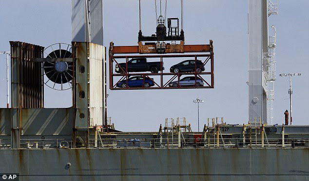 The new deal doubles - to 50,000 - the cars each US automaker can export annually to South Korea. Pictured above is a crane transporting vehicles to a container ship in Oakland