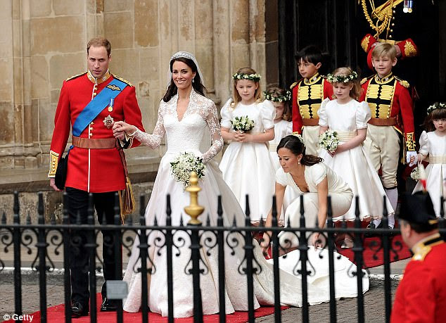 Newly-wed: Prince William Duke of Cambridge and Catherine Duchess of Cambridge leave Westminster Abbey with her sister Pippa supporting her dress