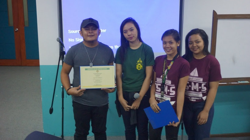 kelvin-lomibao-receives-his-certificate-of-appreciation-as-one-of-the-speakers-of-the-voice-acting-workshop