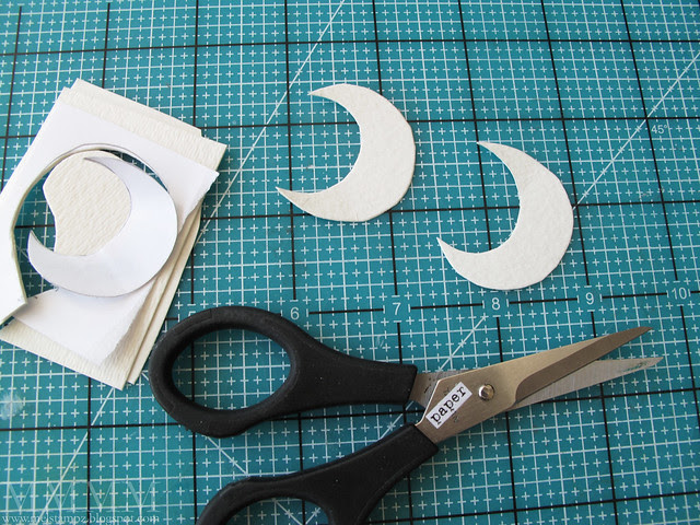 9 Cut out two moon shapes by sticking watercolour paper back to back Make a little template to follow