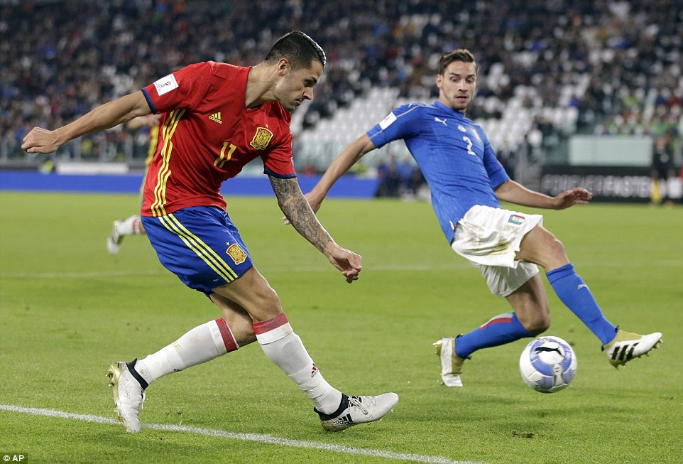 Spain forward Vitola, who started ahead of the likes of Alvaro Morata, tries his luck from an acute angle