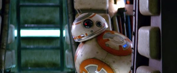 BB-8 peeks out from around the corner of a wall inside the Millennium Falcon in STAR WARS: THE FORCE AWAKENS.