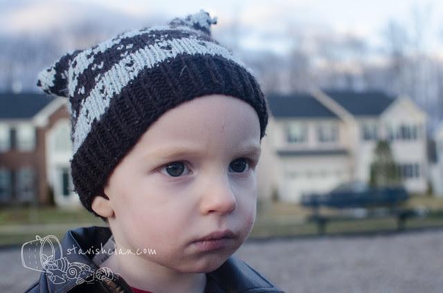 Noah at playgroudn blue hat