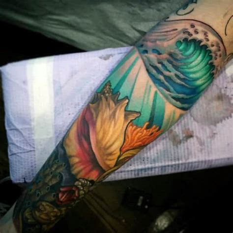 seashell tattoo designs  men oceanic ink ideas