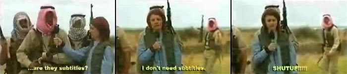 The head of the Iraqi terrorists being interviewed by a reporter.