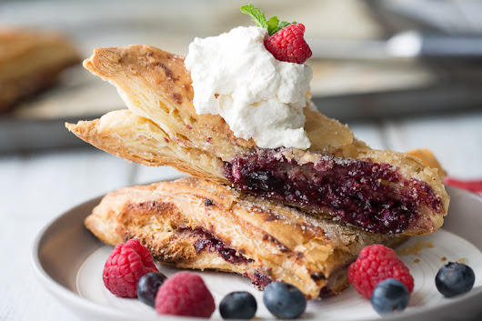 Blue Raspberry Cheesecake Turnovers - Deliciously Plated