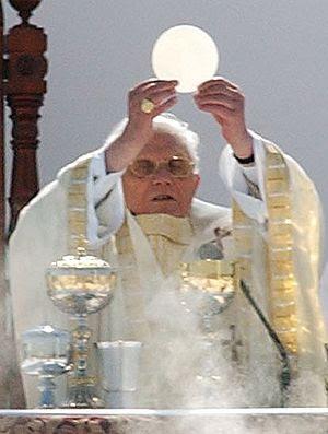 Pope Benedict XVI celebrates the Eucharist, a ...