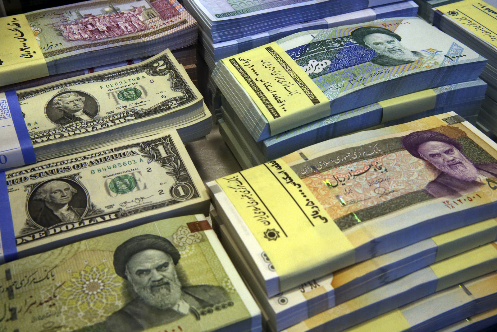 Iranian and U.S. banknotes are on display at a currency exchange shop in downtown Tehran, Iran. (AP/Vahid Salemi)