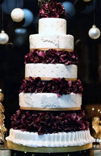 Round 5 tier wedding cake dark red flowers in between