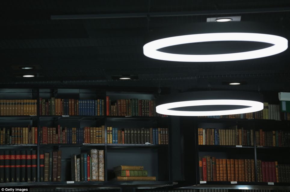 New and old: A small section of the library's vast collection is illuminated by the futuristic lighting