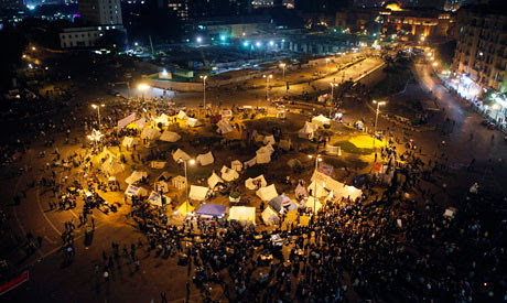 Egyptians occupy the center of Cairo amid protests against President Morsi's decrees. The people are against the further usurpation of power by the government. by Pan-African News Wire File Photos