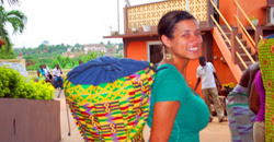Kelly Granger in Ghana with her djembe, a traditional Ghanian drum made from carved wood and goatskin.