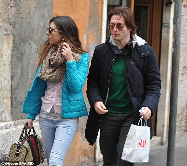 Sollecito (right) reportedly tried to persuade Knox to marry him to give him the the legal protection of American citizenship but since she apparently said no, he has found love with Greta Menegaldo (left)