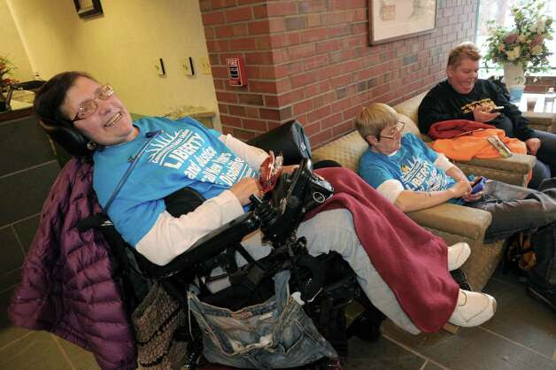 Bobbi Wallach and other members of Adapt, a disabilities advocacy group, occupy the NYS Nurses Association Office, upset that nurses won't back an amendment to a bill that would broaden the kind of caretakers who would be able to perform certain tasks that are now limited to nurses, on Thursday March 20, 2014 in Colonie, N.Y. (Michael P. Farrell/Times Union) Photo: Michael P. Farrell / 00026230A