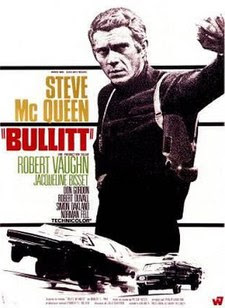 "Reproduction of a movie poster. To the right, there's an image of a man's torso that is reminiscent of the black and white photographs in newspapers. The man is leaning towards the viewer with his left arm. He's wearing a black shirt and a holster on his left shoulder; there's a large pistol in the holster. Printed lettering runs down the left of the poster. It reads (from top to bottom) ""Steve McQueen"" (prominent), ""Bullitt"" (prominent), and then with less and less prominence, ""Robert Vaughn"", ""Jacqueline Bisset"", ""Don Gordon"", ""Robert Duvall"", ""Simon Oakland"", ""Norman Fell"", and ""Technicolor"". Along the bottom of the poster, and beneath the torso image and the lettering, there's an artist's sketch in black and white of two cars, one chasing the other. The artist has superimposed several drawings of each car on top of each other to indicate the high speeds of the cars. Additional lettering runs along the very bottom of the poster, but is illegibly small in this reproduction."