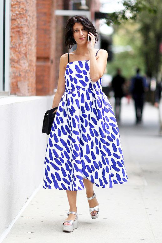Le Fashion Blog Street Style Nyfw Yasmin Sewell Purple And White Whimsical Print Dress Black Clutch Metallic Silver Wedge Sandals Via Popsugar
