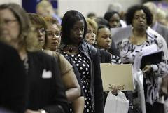 In this Aug. 25, 2010 photograph, job seekers including Lindsey Wright, of Detroit, center, attend a job fair in Southfield, Mich. On Friday, Sept. 3, 2010, the Labor Department issued the August unemployment report. (AP Photo/Paul Sancy) by Pan-African News Wire File Photos